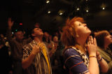DM0795   Bethany Ervin, 16, rejoices to the music during the praise and worship segment of first...