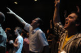 DM0804   Braden Carpenter, center, rejoices to the music during the praise and worship segment of...