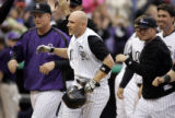 (DENVER shot on 4/4/05)   The Colorado Rockies' Clint Barmes (#12, SS, center) reacts with...