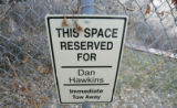 0417 A reservved parking sign for Dan Hawkins is posted near the Dal Ward Athletic Center at the...