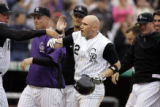 (DENVER shot on 4/4/05)   The Colorado Rockies' Clint Barmes (#12, SS, center) gets a high five...