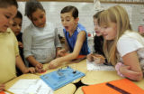 Thomas Jefferies (cq), 9, center, tries to get his group to listen to his plan in Emily Taylor's...