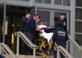 OMAHA  Paramedics rush one of the shooting vicitms out of Von Maur at Westroads Wednesday. (Omaha...