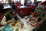 86 year-old Marvin Terrelle (cq) enjoys one of the Good Sheppard Restaurant's specialty, the...