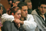 Melissa Quintana (cq) and her husband Josue Olivas (cq) watch as Pedro Cortez (cq) makes his first...
