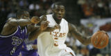 TXHC102 - Texas forward Damion James, right, moves toward the basket as he eludes the defense by...
