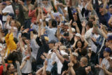 (Denver shot on 4/4/05) Fans react to Colorado Rockies Clint Barmes aft he hit a 2 run homer in...