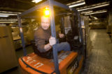 DM0759   Bob Tietz uses a forklift to move packages around at the Denver Bulk Mail Center in...