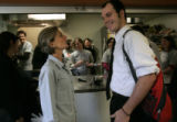 Colorado's First Lady Jeannie Ritter tells Josh Foster (cq) how handsome he looks in his tie as he...