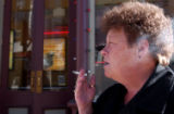 Kay Bluhm, 57, of Denver, smokes on the street outside of the Century Hotel and Casino in Central...