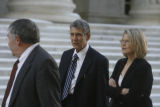 Herbert Stern (cq), (center), and Maureen Mahoney (cq) (at right), attorneys for former Qwest CEO...