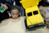 DM0004   Roberto Alvarez, 4, quietly waits his turn to receive a new toy truck during The Denver...
