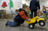 DM0005   David Almanza, 1 1/2, plays with his new toy truck that he got during The Denver Santa...