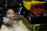 DM0001   Kevin Valdez, 5, anxiously awaits a new toy truck during The Denver Santa Claus Toy Shop...
