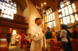 (DENVER, CO. APRIL 3, 2005) (CENTER) Altar Boy Elliot Nelson, 12 (CQ. Elliot Nelson), of Denver...