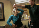 Heritage Club Denver Tech Center resident Valerie Lampe gets twirled by caregiver Tabitha Noxon...