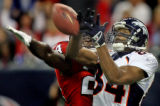 Denver Broncos #84, Javon Walker, right, miss handles a pass as  Houston Texans #24, C.C. Brown,...