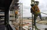 (AURORA, CO., April 19, 2005)  Workers assemble scaffolding at the new Children's Hospital at...