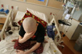 Robi Shaneman, cq, 12 years-old, covers his eyes as he receives chemotherapy Thursday Nov. 29,...
