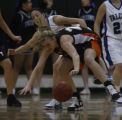 Highlands Ranch's #3 Meagan Fulps watches as Lakewood's #21 Theresa Clark lose control of the ball...
