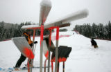 Course grooming equipment sits idle until snow cats can remove snow from the Birds of Prey course...