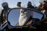 DM0645   Rich Decino, 48, of Arvada keeps his face warm behind a Santa Claus beard as he gets...