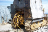 This photo shot last week shows the beginning of the disassembly of the armored bulldozer that...