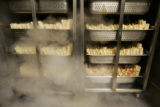 Tamales steam in a custom steamer made by the owner of Las Casitas, Paul Sandoval. (JUDY...