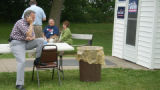 Tancredo calls his wife about household chores after a campaign stop near Dubuque, Iowa, june 24,...
