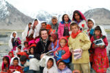Greg Mortenson, executive director of nonprofit Central Asia Institute, with schoolchildren of...