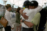 Sean Swarner, cq, two-time cancer survivor and Colorado resident, hugs close friend Ryan Evans,...