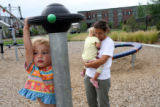 2 year-old Alea Carlson (cq) plays at the Puddle Jumper Park in Stapleton, as her mother Lucy...