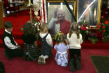 (DENVER, Colo., April 3, 2005) A group of children pray in front of a photograph of Pope John Paul...