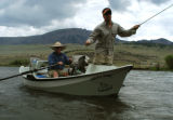 Joel Condren positions his driftboat for Travis Steffens on the upper Rio Grande, above Creede,...