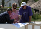 Left to right, Contractor Dan Tefertiller (cq)  Jana and Shannon Rushton go over construction...