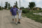 Shannon Rushton walks with his son Stetson in their neighborhood in Holly , CO Tuesday July 10,...