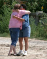 Jana Rushton, left is hugged by friend Dicie Isley (cq) at the cobnstruction site where  the...