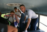 Cadet Lt. Col. Adam Voci, cq, yells at new basic cadets to get off his bus, Thursday morning June...