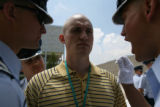 Air Force Academy cadets get in the face of Jacques Lamoureux, Thursday June 27, 2007 as he stands...
