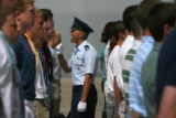 An Air Force Academy cadet gets the attention of newly arrived basic cadets Thursday morning June...
