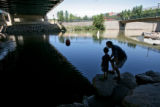 Jonah Goldin/Dubois, 5, left, and his friend Rich McClintock (cq) enjoy visiting the South Platte...