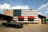 An American flag covers the south side of the Sedalia Grill, Wednesday morning, June 27, 2007,...