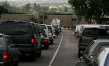 Traffic waits on Main Street for a train, Wednesday morning, June 27, 2007, Sedalia. The town has...
