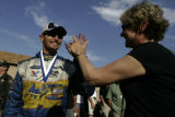 Funny Car Champion Jack Beckman celebrates his win on Sunday July 15, 2007 during the final day of...