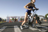 A competitor starts the bike leg of the triathalon at the 8th annual Danskin Triathalon at Aurora...