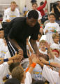 Nuggets player J.R. Smith instructs and interacts with campers during his Camp Melo at the Gold...