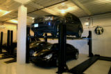 Autos of owners of private jets are parked at an indoor parking area at XJet, Tuesday morning,...