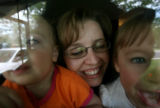 thru the front picture window, left to right, Olivia, Rachel and Sophia Zenzinger (cq mom and kids...