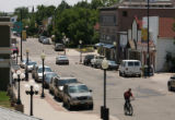 MJM350 A bicyclist rides down Main St. in downtown Louisville, Colo. Monday July 16, 2007.  The...