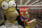 Homer holds the last of the boxes of KrustyO's cereal. The cereal already sold out except for a...